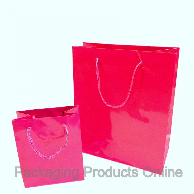 A small and medium sized glossy pink gift bag with pink cord handles